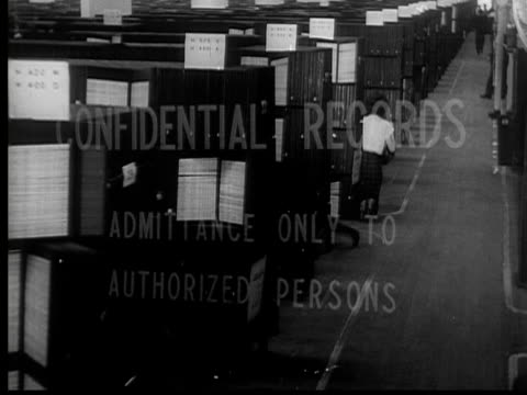1954 b/w montage cu confidential records department sign / ha ws people working among aisles of files / usa - sozialversicherung stock-videos und b-roll-filmmaterial