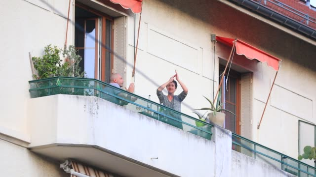 confined people go out to the windows at 8 pm to applaud the caregivers who are fighting against the covid19 virus on april 11 2020 in chambery france - tax stock videos & royalty-free footage