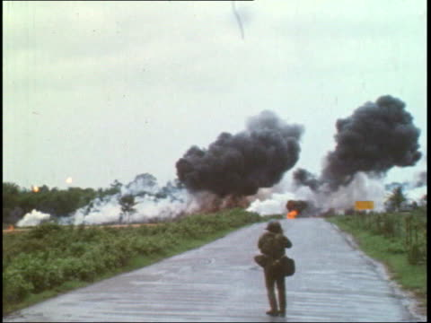 confirmation of white phosphorus munitions used by US troops FILE / 961972 Napalm bomb dropped on road as watched by US soldier in f/g Children...