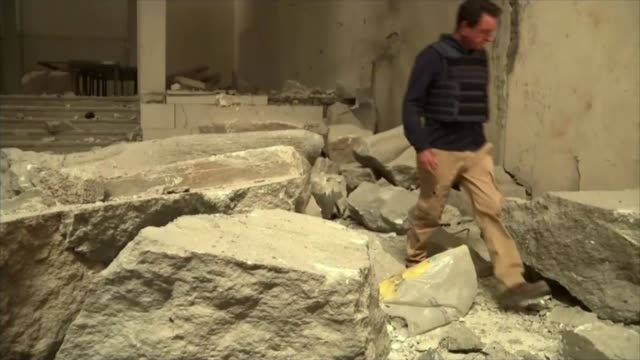 800 year old Great Mosque of alNuri in Mosul destroyed by Islamic State T14031720 / TX Mosul Reporter along over rubble Information panel on floor...