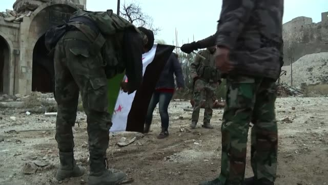 aleppo evacuation suspended as ceasefire breaks syrian soldier putting up large photograph of syrian president bashar al assad at roadside checkpoint... - poster stock videos and b-roll footage