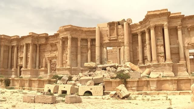 ancient city of palmyra desecrated by war syria palmyra ext ruins of roman theatre in ancient palmyra pan various shots of ruins of roman... - amphitheatre stock videos & royalty-free footage
