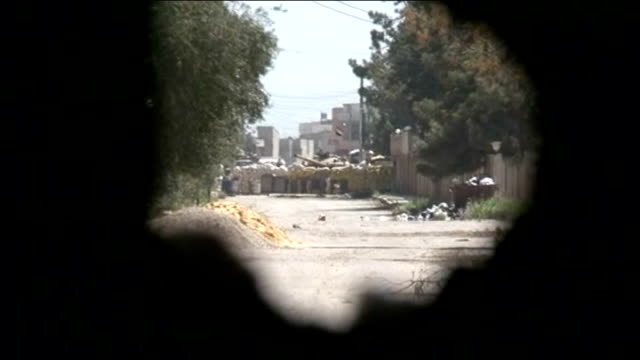 Assad forces seize back control of Qusair from rebels T17041201 / TX Reporter along in back of truck Rubble inside building and holes in wall View...