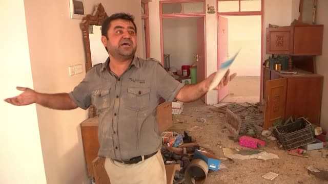 attempt to recapture mosul from islamic state continues badana int man along looking through ruined house and talking to camera sot shot along... - isil conflict stock videos & royalty-free footage