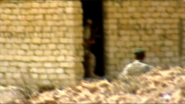 battle for bani walid continues libya near bani walid ext long shot truck carrying national liberation army soldiers free libyan army / fighters... - schlacht stock-videos und b-roll-filmmaterial