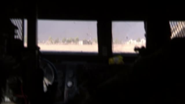 Battle for Mosul continues IRAQ near Mosul EXT Column of Iraq Special Forces vehicles on desert road silhouetted against dawn sky Iraqi froces...