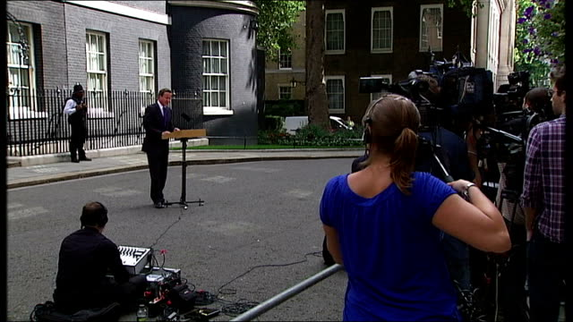 battle for tripoli england london downing street ext david cameron mp along from number 10 to podium david cameron mp statement to press sot his... - lectern stock videos & royalty-free footage