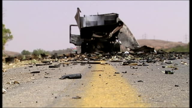 beni walid tribal leaders remain loyal to gaddafi libya burnt out lorry thought to have been attacked by a british apache helicopter at side of road... - apache helicopter stock videos and b-roll footage