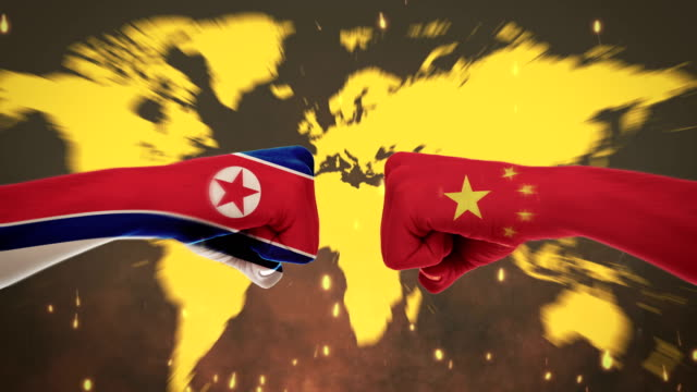 conflict between male fists - governments conflict concept, china and north korea, flags - green screen - fist stock videos & royalty-free footage