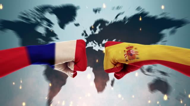 stockvideo's en b-roll-footage met conflict tussen mannelijke vuisten - regeringen conflict concept, frankrijk en spanje, vlaggen - menselijke arm