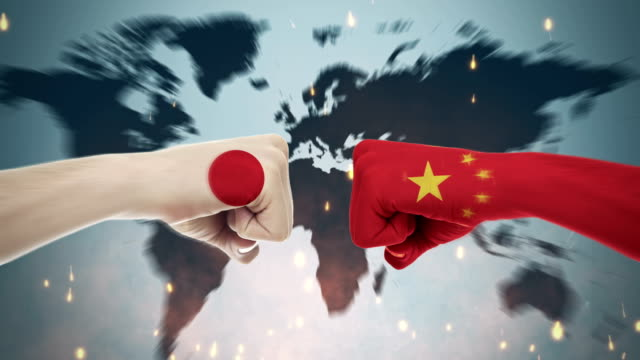 Conflict between male fists - governments conflict concept, Japan and China, Flags