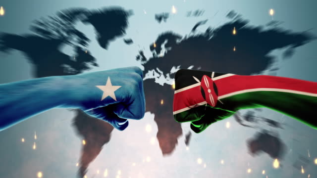 conflict between male fists - governments conflict concept, kenya and somali, flags - kenyan flag stock videos & royalty-free footage