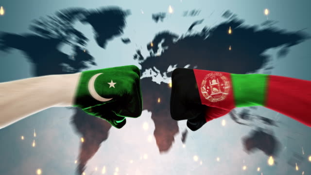 conflict between male fists - governments conflict concept, pakistan and afghanistan, flags - pakistani flag stock videos and b-roll footage