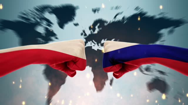 Conflict between male fists - governments conflict concept, Russia and Poland, Flags