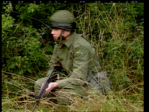 conflict border patrols republic of ireland / northern ireland border ms irish army landrover along lr followed by armoured patrol vehicle ms 27th... - 北アイルランド点の映像素材/bロール