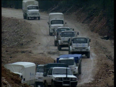 bosnia and herzegovina aid convoys suspended after attack/un safe havens itn convoy as along towards pull out ms unhcr jeep at base cs bullet holes... - bosnia and hercegovina stock videos & royalty-free footage