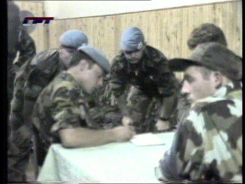 stockvideo's en b-roll-footage met bosnia uk reinforcement/ hostage release/ f16c downed cf tape no longer available anat bosnia on cms un hostages grouped around table pale tv cms un... - 1995