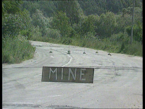 """british soldier killed; cf tape no longer available bosnia- cms sign suspended from wire across road ) herzegovina """"mine"""" pull out as white un... - bosnia and hercegovina stock videos & royalty-free footage"""