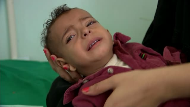 case study of british doctor t28111701 / yemen aden int ahmed couging in mother's arms catheter on hand tilt up ahmed with ragged breathing - diphtheria stock videos & royalty-free footage