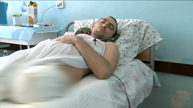 stockvideo's en b-roll-footage met ceasefire agreement breached five ukrainian soldiers killed in fighting horlivka almostdeserted city centre street entrance of 'hospital number 2'... - shell merknaam