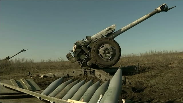 ceasefire largely holds with some sporadic fighting ext rebel artillery gun in field artillery gun and shells on ground artillery guns lined up - artiglieria video stock e b–roll