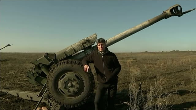 stockvideo's en b-roll-footage met ceasefire largely holds with some sporadic fighting south of debaltseve int pov shot through window of tv van as along country road past roadblocks... - number 9