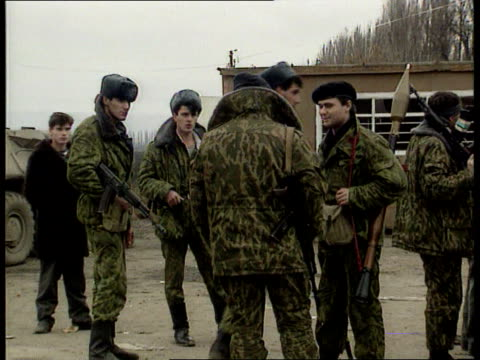 conflict: chechnya: dispute with russia; russian federation: conflict: chechnya: dispute with russia; ext troops and apcs cms chechen militia group... - grosny stock-videos und b-roll-filmmaterial