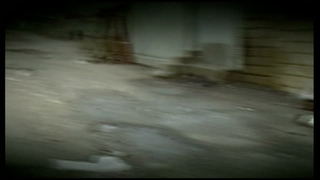 chemical attack: call for diplomatic action; t22038804 / iran / iraq border: halabja: bodies scatted about on road l-r more bodies - iraq video stock e b–roll