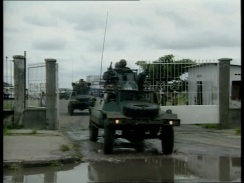 civil war itn kinshasa airport gv airport bldg and car park la control tower zairean army troops standing around by armoured vehicles at airport ms... - bürgerkrieg stock-videos und b-roll-filmmaterial