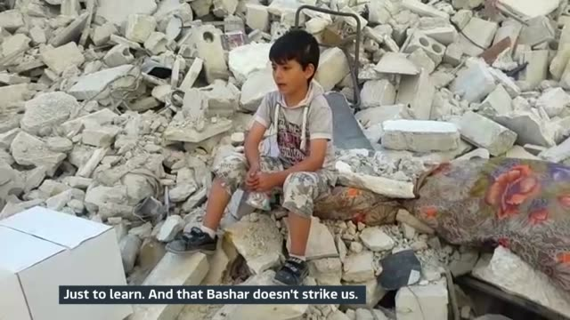 aleppo residents young boy sitting on pile of rubble as interviewed sot our dream is to learn just to learn and that bashar doesn't strike us young... - schutt stock-videos und b-roll-filmmaterial