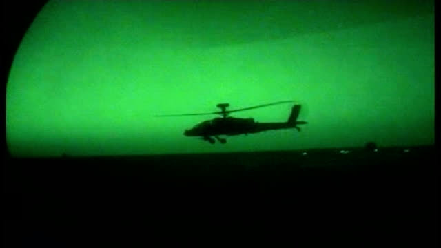 inside an ambushed british unit; afghanistan: sangin: ext / night night vision sequence air to air apache attack helicopter flying along int... - skibrille stock-videos und b-roll-filmmaterial