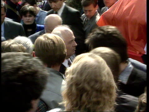 coup funerals/ gorbachev resigns as communist party leader; ussr: moscow: ext tgv big funeral crowd - many with russian republic flags - pull out tgv... - touching stock videos & royalty-free footage