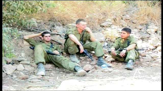 Day 16 Israeli bombardment intensifies across border area Israeli soldiers sitting resting Three Israeli soldiers looking tired sitting resting...