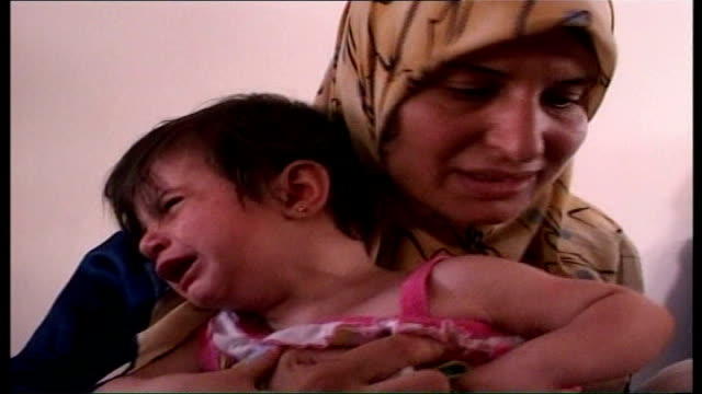 day 17 shelling of southern lebanon continues int close shot of young boy's face seated in back of van as in tears muslim woman sits in back of van... - elbow stock videos & royalty-free footage