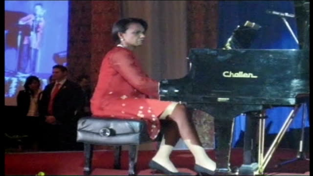 Day 17 shelling of Southern Lebanon continues VIA MALAYSIA Kuala Lumpur INT Condoleezza Rice playing piano on stage with violinist during annual gala...