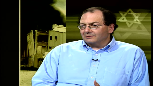 day 18 hezbollah leader pledges more attacks as israeli offensive continues england london gir int nadim shehadi interview sot you have the israelis... - israelisches militär stock-videos und b-roll-filmmaterial
