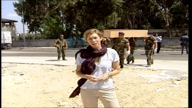day 18 lebanese war victims buried in mass grave soldiers carrying coffin pan reporter to camera - mass grave stock videos and b-roll footage