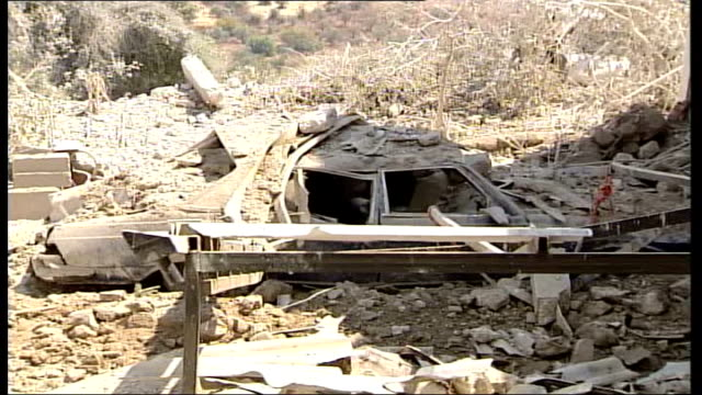 day 19 un building attacked after deaths of 37 children in qana ext wreckage of car underneath rubble devastated ruins on building with debris strewn... - 2006 stock videos & royalty-free footage