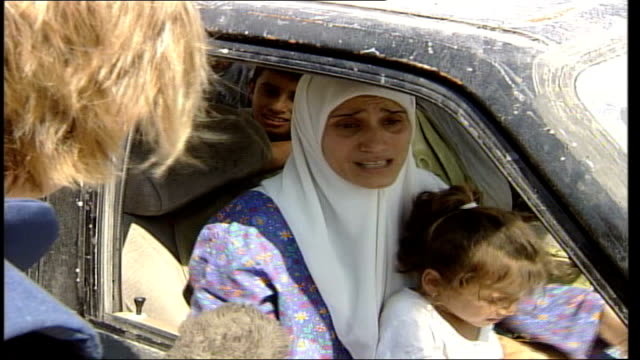 day 20 extent of destruction in southern lebanon reporter speaking to woman in car sot we have to runwe have children we have been shelled for 20... - ceasefire stock videos and b-roll footage