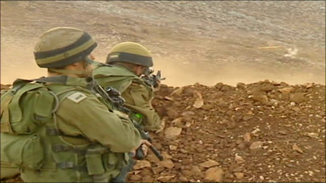 stockvideo's en b-roll-footage met day 22 israeli ground attack idf incursion into lebanon ext day israeli tank driving away throwing up cloud of dust / tank towards coming over ridge... - israëlisch leger
