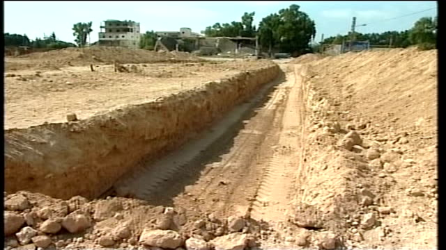 day 22 qana funerals postponed freshly dug mass grave site as sound of shelling heard sot - mass grave stock videos and b-roll footage