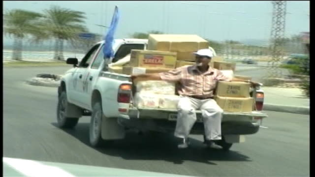 day 23 hezbollah rocket attacks / beirut bombed lebanon tyre view man travelling on back of truck loaded with boxes containing basic necessities... - hezbollah stock videos & royalty-free footage