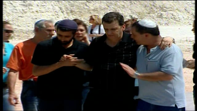 day 24 northern israel bombing aftermath and funerals male mourner supported by colleagues - mourner stock videos and b-roll footage