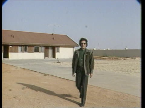 Day 3 LIBYA Tripoli MS Col Khadafi in dark glasses towards PAN RL to BV into tent