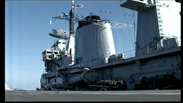 day 8 british evacuees arrive in cyprus hms illustrious control tower of british aircraft carrier hms illustrious low angle shot of royal navy ensign... - hms impulsive stock videos & royalty-free footage