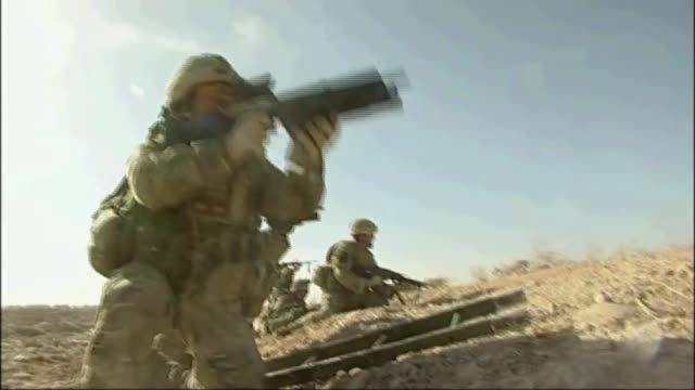 donald trump commits more troops to afghan war t07071001 / tx 772010 british troops coming under fire from suspected taliban insurgents gunfire heard... - conflittualità video stock e b–roll
