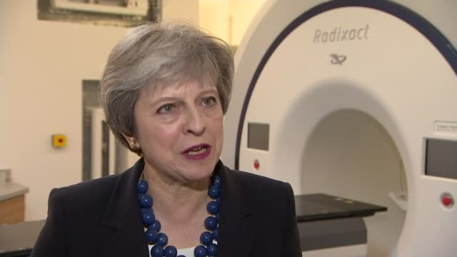 donald trump promises a response to chemical weapons attack; england: cambridgeshire: cambridge: addenbrooke's hospital: int theresa may mp chatting... - kentish town bildbanksvideor och videomaterial från bakom kulisserna
