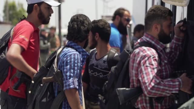 Evidence emerges that Syrian regime is killing 50 rebel prisoners a day SYRIA Homs EXT Long shots Syrian rebel fighter holding gun in one hand and...