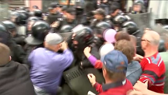 fighting spreads to Odessa 152014 / T01051416 Donetsk ProRussian marchers calsh with ropt police in street during ProRussian May Day march