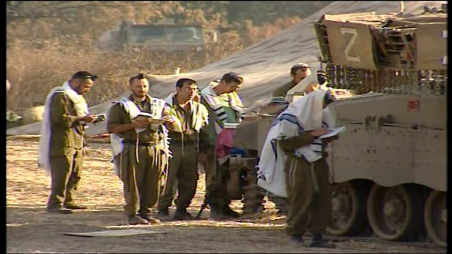 First day of ceasefire Northern Israel ISRAEL Israeli soldiers hugging one another after the ceasefire has begun / Soldiers towards / Soldiers...